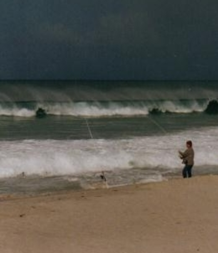 Fisherman On Beach On Stormy Day