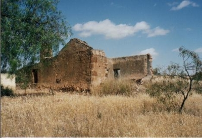 Ruin surrounded by dry grass